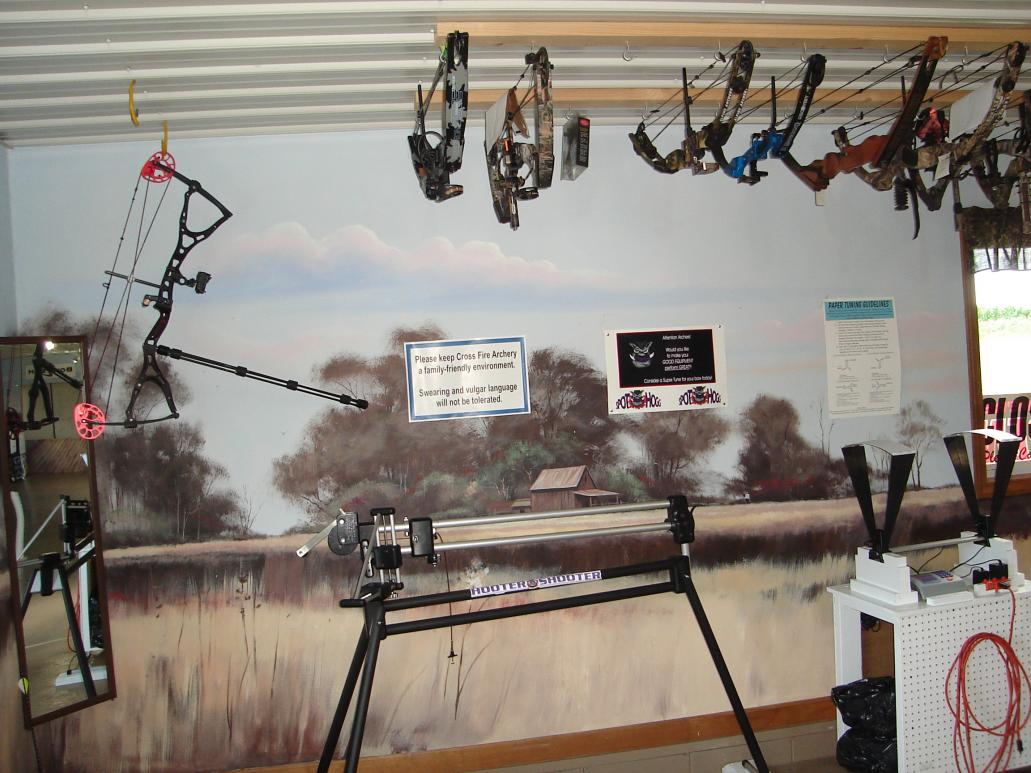 Archery shops with cool huntining murals in their shooting lane
